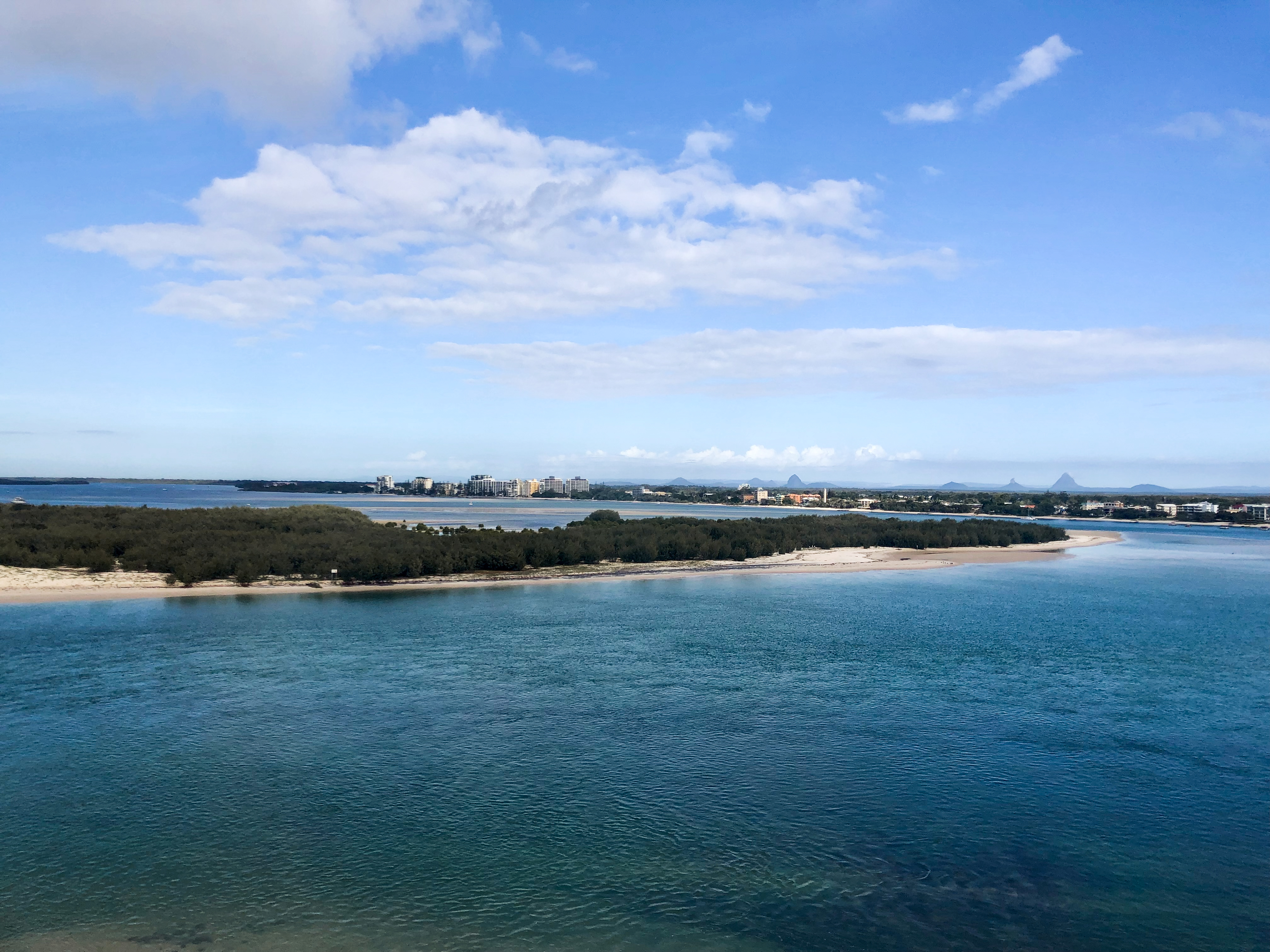 View of Bribie Island from Caloundra with the Glass House Mountains in the distance