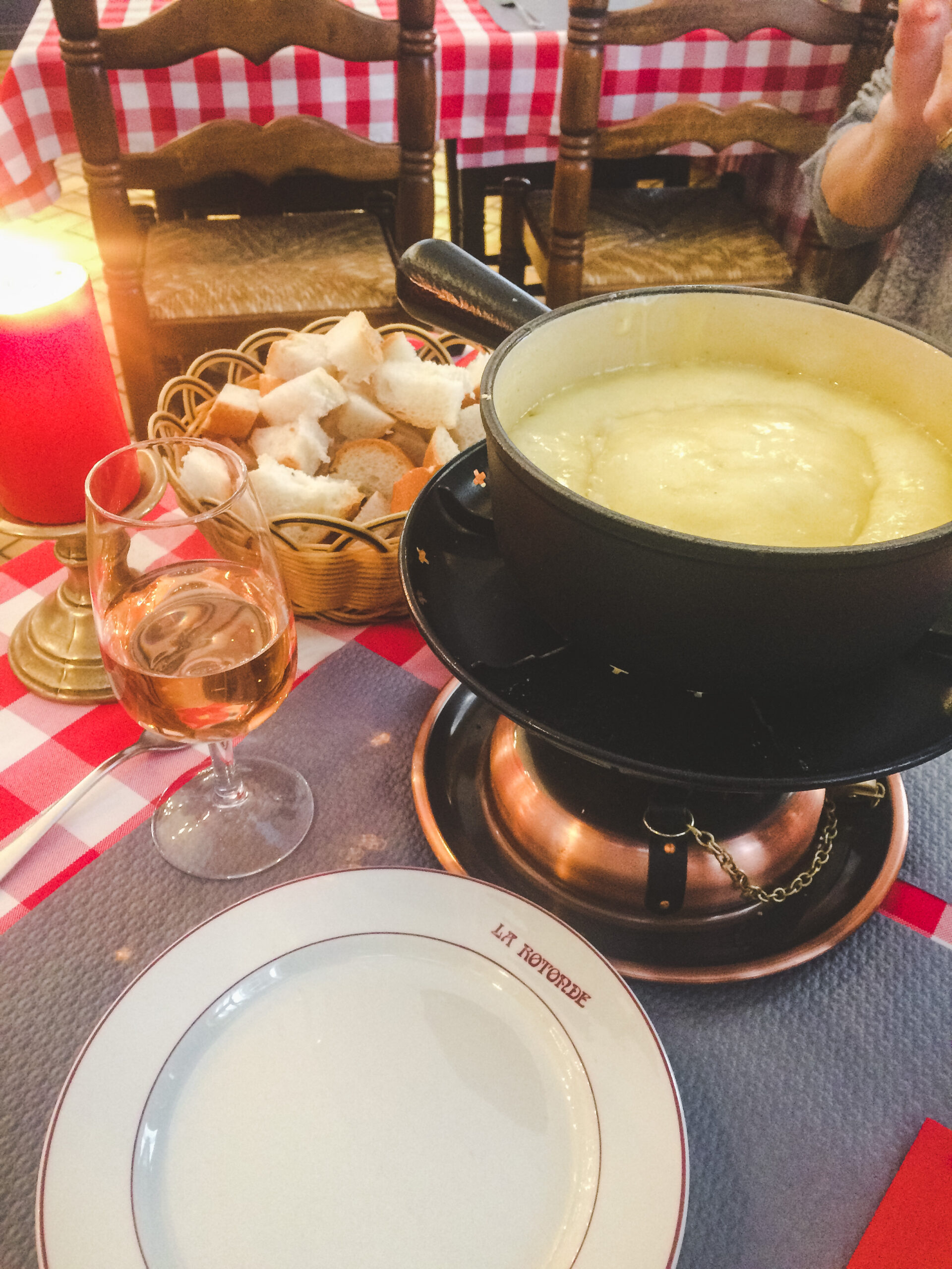 Eating delicious cheese fondue, a must-do in Switzerland!