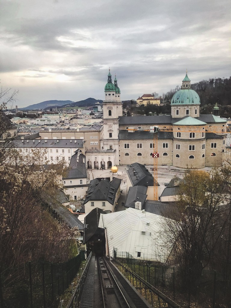 There are two ways to reach the fortress: a steep 15-minute walk from the city centre or a fun ride up the cliff in the glass Festungsbahn funicular.