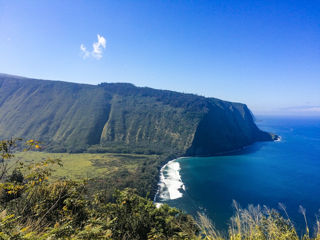 Waipi'o Valley is one of the Big Island's most iconic views. Located at the end of Hwy 240, this lookout offers a stunning view of the lush valley below.
