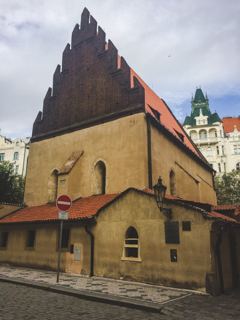 The Old-New Synagogue was completed in 1270 and is Europe's oldest working synagogue and one of Prague's earliest Gothic buildings. You step down into it because it predates the raising of Staré Město's street level in medieval times to guard against floods.