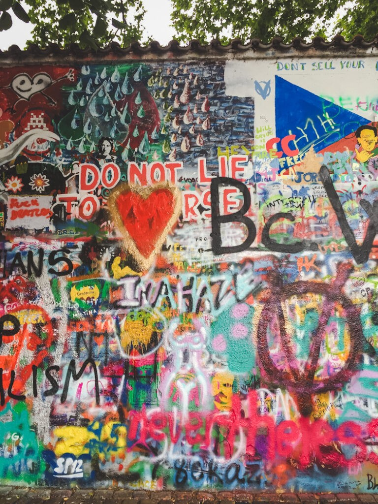 After his murder in 1980, John Lennon became a pacifist hero for many young Czechs who painted images of Lennon, political graffiti, and Beatles lyrics on the newly named John Lennon Wall.