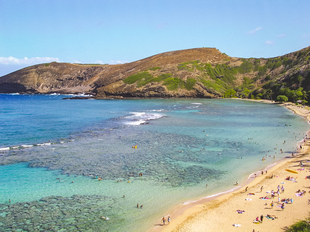 From the overlook above Hanauma Bay, you can see the translucent waters that attract tourists from around the world and trace the outline of the 7000-year-old coral reef that stretches across the bay.